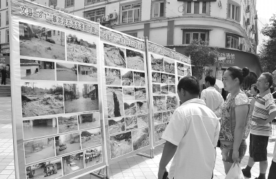 """8月15日,文县举办了""""8.7""""暴洪泥石流灾害图片展,展现了碧口等乡"""