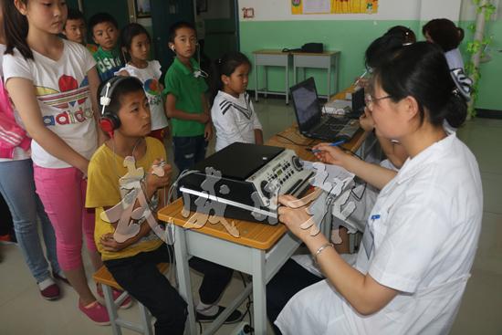 武威市认真实施贫困听力残疾人救助项目(图)
