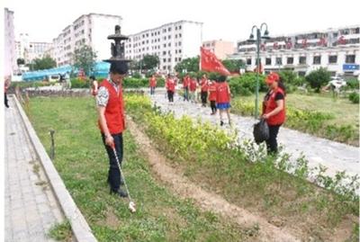 嘉峪关市新华社区志愿者开展卫生大清扫活动