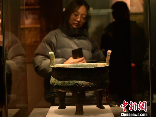 甘肃举行早期秦文化特展 讲述流失海外文物回归故事